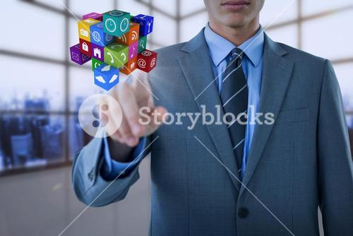 Composite image of midsection of well dressed businessman pointing cube