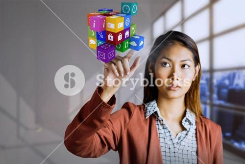 Composite image of businesswoman pointing cube