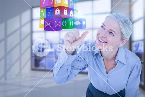 Composite image of smiling businesswoman pointing cube