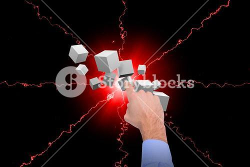 Composite image of businessman hand pointing at digitally cubes