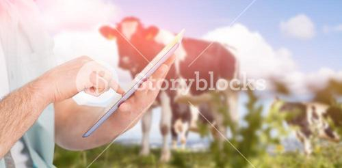 Composite image of man using tablet pc against rural scene