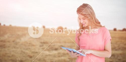 Composite image of hipster woman holding tablet pc
