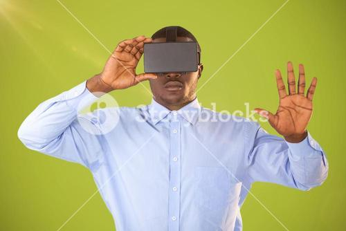 Composite image of man with virtual reality headset on green background
