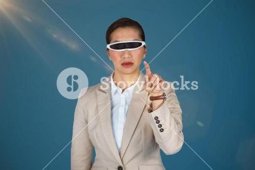 Composite image of confidence businesswoman using virtual video glasses