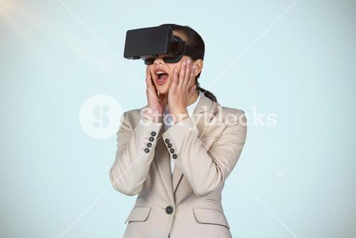 Composite image of surprised businesswoman wearing virtual video glasses