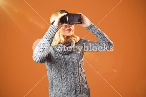 Composite image of woman with blond hair using virtual reality headset