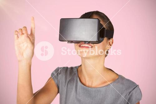 Composite image of woman pointing while using virtual reality glasses