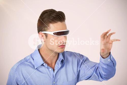 Composite image of man gesturing while using virtual video glasses