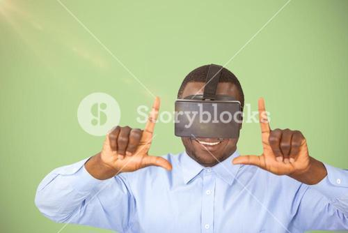 Composite image of man using virtual reality headset while gesturing against white background