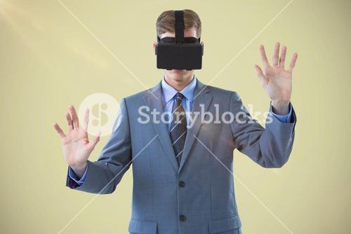 Composite image of businessman using virtual reality headset