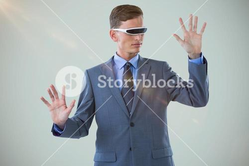 Composite image of businessman imagining while using virtual reality glasses