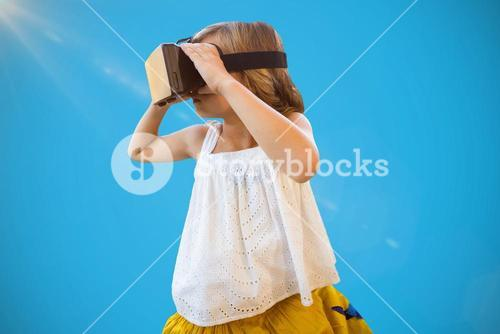 Composite image of girl wearing virtual reality simulator