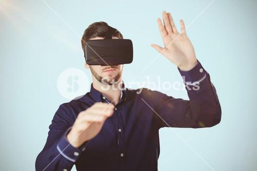 Composite image of businessman holding virtual glasses on a white background
