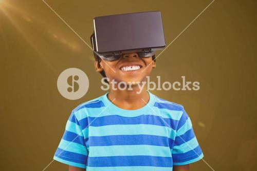 Composite image of boy using a virtual reality device