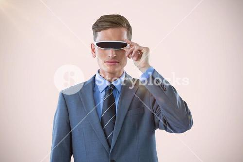 Composite image of handsome businessman virtual reality glasses