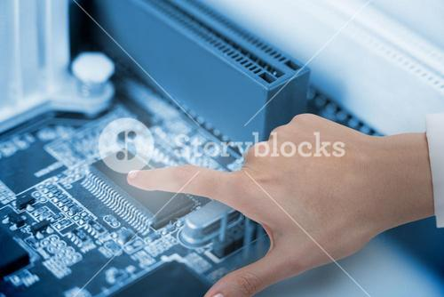 Composite image of hand of female doctor using digital screen