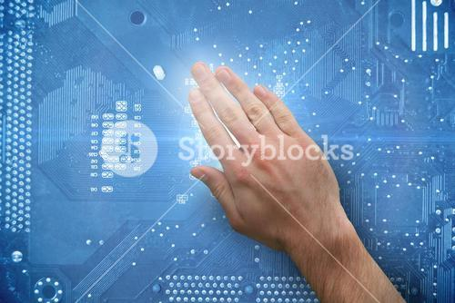 Composite image of hand touching digital board