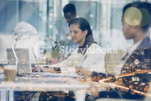Concentrated businesswoman working on laptop