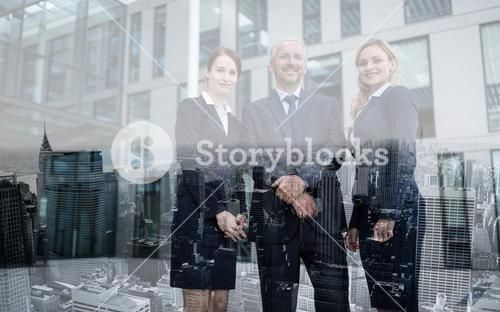 Confident businesspeople standing in office premises