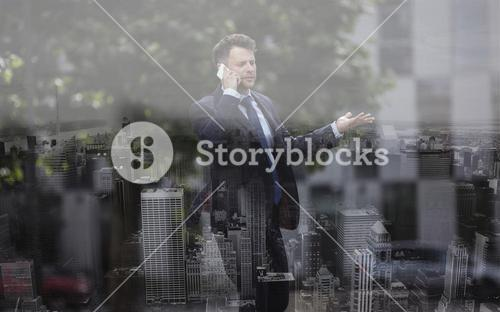 Confused businessman communicating on mobile phone
