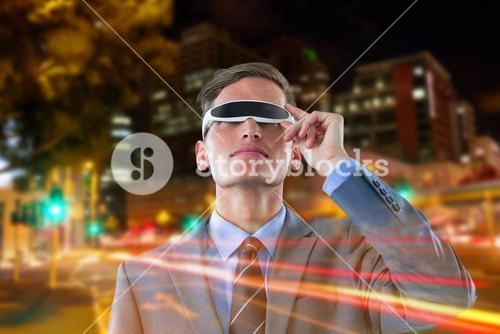 Composite image of businessman using virtual reality glasses against white background