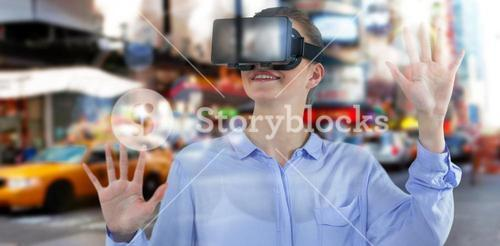 Composite image of businesswoman experiencing virtual reality