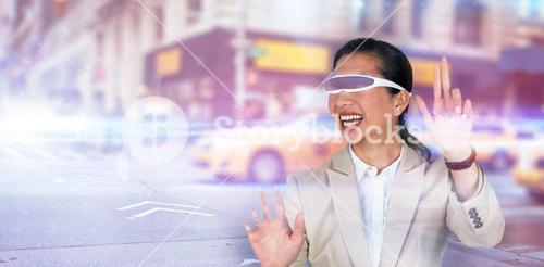 Composite image of happy businesswoman wearing virtual video glasses