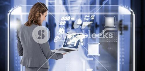 Composite image of rear view of businesswoman using laptop 3d