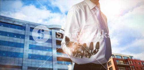 Composite image of midsection of businessman with robotic hand 3d