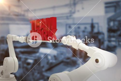 Composite image of robotic hand holding red team work text over white background