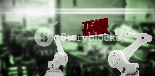 Composite image of mechanical hands holding team work message on white background