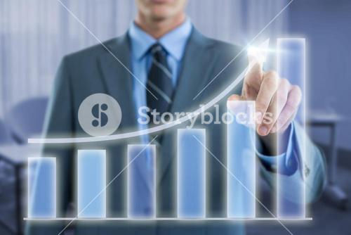 Composite image of well dressed businessman pointing at virtual graph