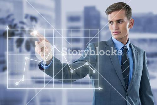 Composite image of well dressed young businessman touching virtual graph