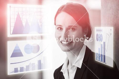 Composite image of business woman against virtual graph
