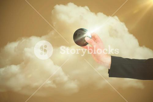 Composite image of businessman in suit holding little earth