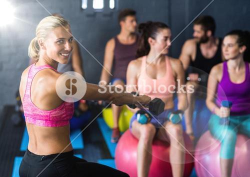 Aerobics with flare against a gym room background