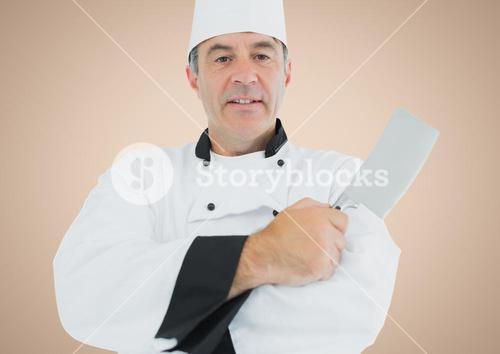 Chef with knife against cream background