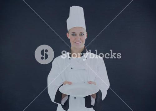 Composite image of Chef with plate against navy background