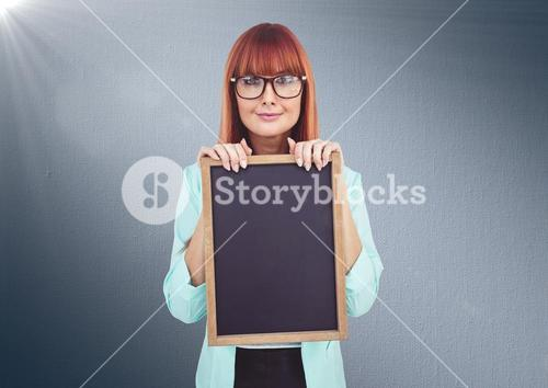 Composite image of Woman with blackboard against navy background
