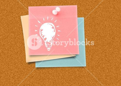 Sticky Note with Light bulb Idea against a board