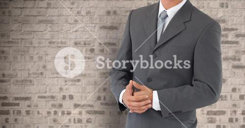 Businessman Torso against a stone wall