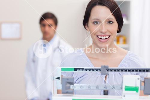 Smiling woman on the scale