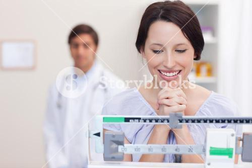 Smiling woman excited about the scale