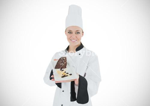 Chef with cake slice against white background