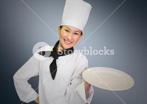 Chef with plate against grey background
