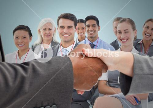 Handshake with business people and blue background