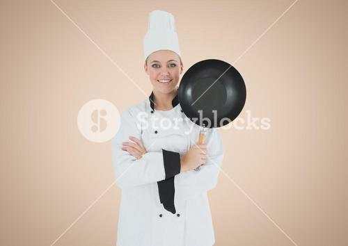 Chef with frying pan against cream background