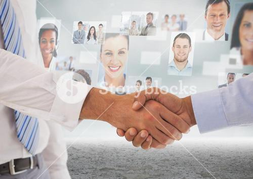 Handshake in front of sky with business people