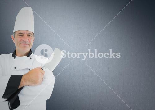 Chef with knife against grey background