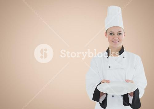 Chef with plate against cream background
